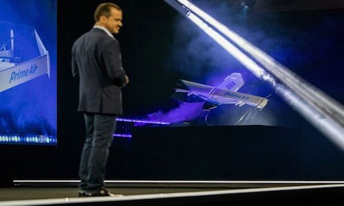 Amazon's Jeff Wilke demos the Prime Air delivery drone.